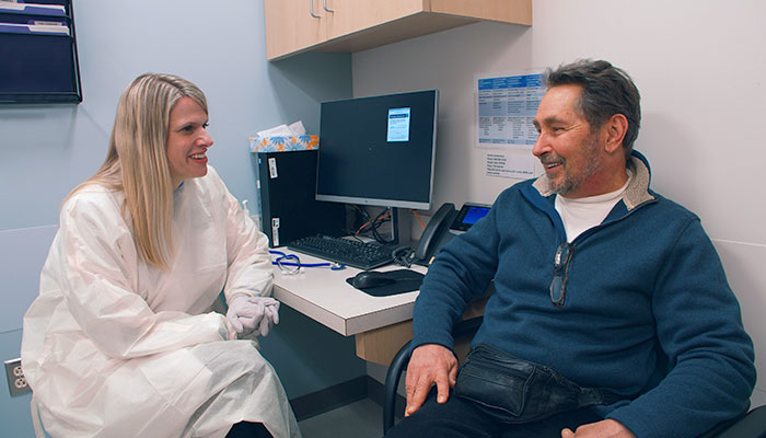 Doctor and Patient discussing Hepatitis C-Infected Hearts and Lungs Safely Transplanted