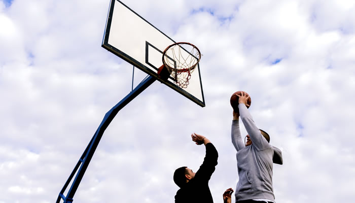 Two men playing baskettball