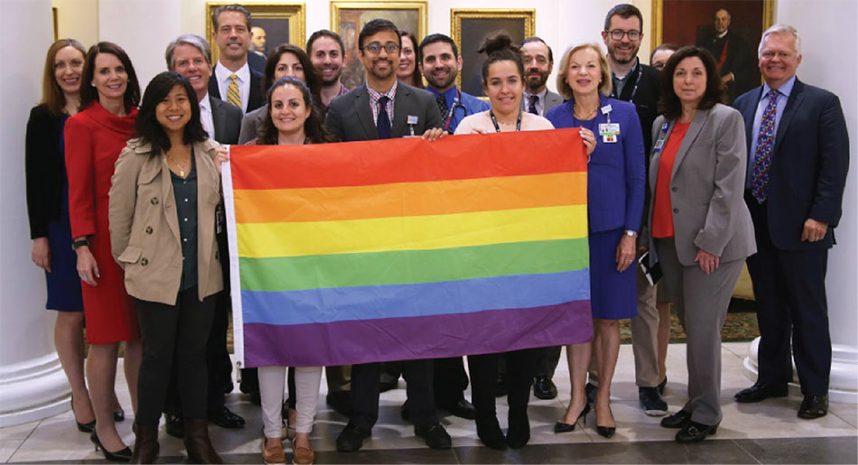 Group photo with rainbow pride flag