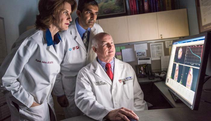 Bone and joint disease specialists from Brigham and Women's Hospital look at test results.